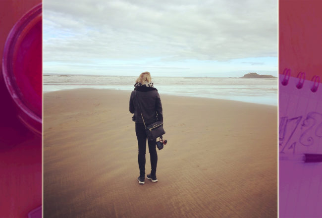 girl standing alone on a Scottish beach at Archerfield House