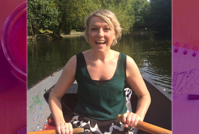 Girl on a row boat smiling